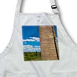 click on An Old Silo in a Yard in Enterprise, Utah With a Deep Blue Sky and White Clouds in Detail to enlarge!