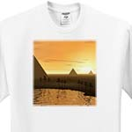click on The Giza Necropolis sun rises over the desert sands near Egyptian pyramids at Giza to enlarge!