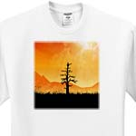 click on Sunlit Tree silhouette of leafless tree alone in field with mountains and sunny horizon to enlarge!